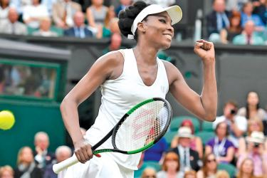 US player Venus Williams celebrates beating Latvia's Jelena Ostapenko during their women's singles quarter-final match on the eighth day of the 2017 Wimbledon Championships on July 11 AFP