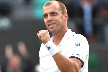 Luxembourg's Gilles Muller reacts after winning against Spain's Rafael Nadal during their men's singles fourth round match of the 2017 Wimbledon Championships AFP