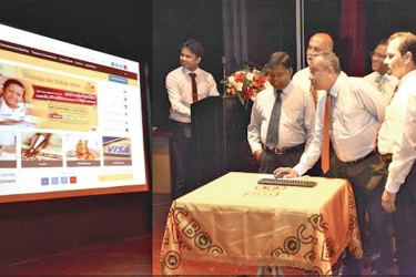Chairman of the Bank of Ceylon, President's Counsel Ronald C. Perera launching the new website with the 'Apply Online' feature