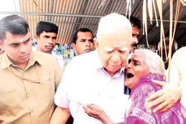 Opposition Leader R.Sampanthan who met with the relatives of missing persons in Killinochchi is seen consoling a woman.