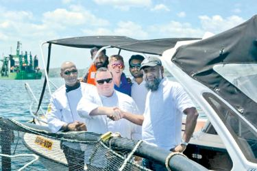Galle Face Hotel,Chef De Cuisine, Jagath Ravindra Liyanage, Galle Face Hotel, Executive Chef, Adam Gaunt Evans, Oceanpick, Founder/Director,Irfan Thassim during a visit to the Round Island Barramundi farm in Trincomalee
