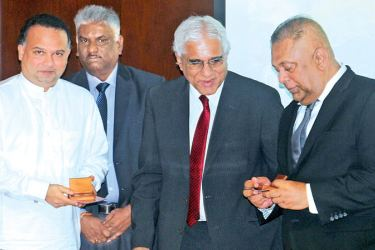J. P. R. Karunaratne, Director Central Currency Unit Central Bank with Ministers Mangala Samaraweera, Navin Dissanayake and Governor Central  Bank, Indrajit Coomaraswamy after issuing the new coins. Picture by Saliya Rupasinghe