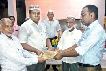 The land deed being handed over