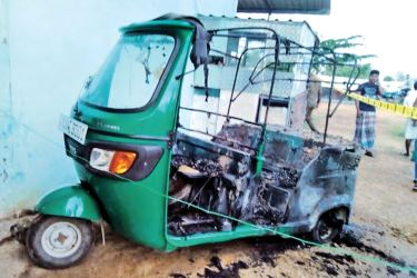 The torched three-wheeler