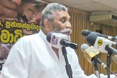 Election Commission  Chairman Mahinda  Deshapriya addressing the gathering at the seminar.  Picture by Gandara Group Corr.