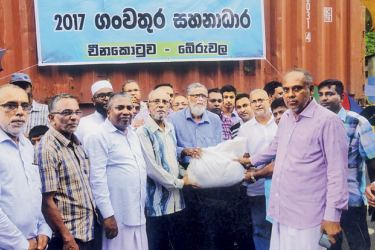 The members of the China Fort Mosque Association led by China Fort Traders' Association President Dr. M Z M Nizar and China Fort Mosque Board of Trustee Vice President Al Haj Hilmy Cassim, handing over the stock of relief goods to members of the Ratnapura Gem and Mining Traders' Association led by its President K. R. Ananda.  Picture by B M Mukthar, Beruwala Special Corr.
