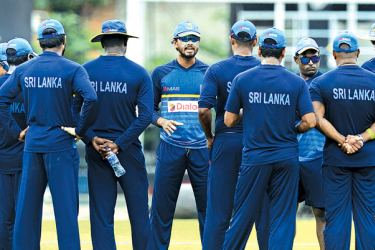 Sri Lanka's new Test captain Dinesh Chandimal addresses the team at the R Premadasa Stadium yesterday ahead of the one-off Test against Zimbabwe starting today. AFP