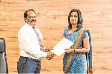 NSBM Vice Chancellor Dr. E. A. Weerasinghe and NDB Securities Manager – Research  Dhinali Peiris  exchanging the signed MoUs at the signing ceremony held at NSBM Green University Town, Pitipana, Homagama
