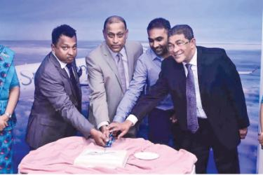 SriLankan Airlines Director Harendra K. Balapatabendi together with Chief Commercial Officer Siva Ramachandran, SriLankan Brand Ambassador and former Sri Lanka Cricket Captain Mahela Jayewardene and SriLankan Airlines, Consultant Lal Perera cutting a cake minutes before the inaugural flight to Hyderabad