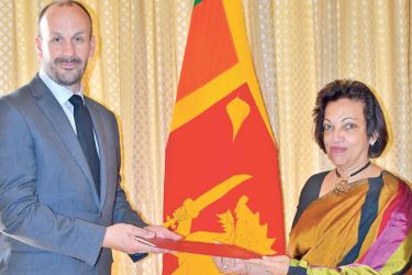 Prof. Michael Phillip Eddleston receiving the appointment from the High Commissioner Amari Wijewardene at the High Commission of Sri Lanka in London