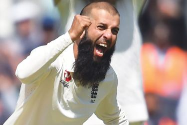 England's Moeen Ali celebrates the wicket of South Africa's Chris Morris for 24 on the fifth and final day of the third Test match between England and South Africa at The Oval cricket ground in London on July 31,