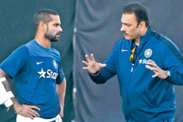 Dharamshala : Team India's director of cricket Ravi Shastri talks to Shikhar Dhawan during a practice session in Dharamshala on Thursday ahead of the 4th ODI cricket match against West Indies. PTI Photo by Shirish Shete