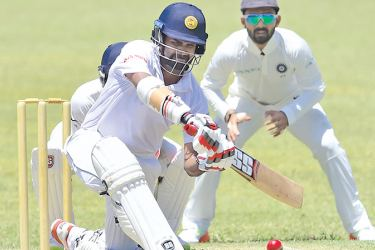 Lahiru Thirimanne batting for SLC President's XI against India in the two-day warm-up match played at the CCC grounds. He scored a sedate 59. – AFP