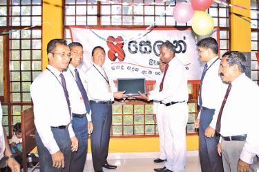 Seylan bank officals making the donation of the library