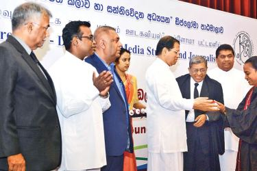 """President Maithripala Sirisena handing over a diploma certificate to a person who followed """"Diploma in Media Studies and Journalism"""" course conducted by the Sri Lanka Press Council. Finance and Mass Media Minister Mangala Samaraweera, Deputy Ministers Lasantha Alagiyawanna, Karunarathna Paranawithana, Sri Lanka Press Council Chairman Bandukla Wellala and Indian Press Council Chairman, Justice, Chandramauli Kumar Prasad are also in the picture."""