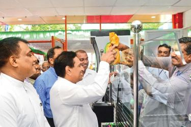 Health Minister Dr. Rajitha Senaratne issues the drugs for the first prescription given at the 35th osu sala outlet opened at Piliyandala.
