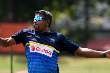 Veteran spinner Rangana Herath proves his fitness at practice at the SSC grounds yesterday. Herath was recovering from a injury to his bowling hand. - AFP