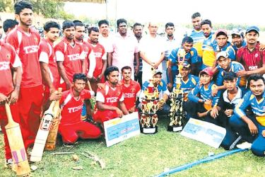 Champion New Sun SC team (blue & yellow) and runner-up Thurai Neelawanai Central SC team (red) with their trophies