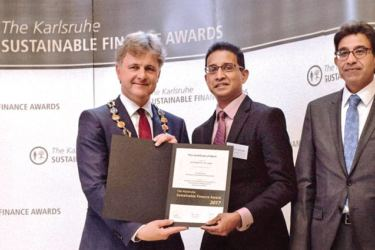 Senaka Jayasinghe receiving the award from Dr. Frank Mentrup Lord Mayor of Karlsruhe in the presence of Arshad Rab, CEO of the European Organisation for Sustainable Development