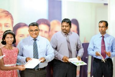 Fahim Shakoor, General Manager, Business Development-City & Guilds, Ranmal Godigamuwa-Manager,Business Development- City & Guilds and Koshitha Peramunugamage - Head of Singer Business School at the Singer Computer Academy graduation