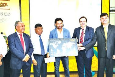 """The Bank of Ceylon's long standing customer,  Cricketer T.M. Dilshan receiving the """"BOC Travel Card"""" at the ceremony held for the Bank's 78th Anniversary."""