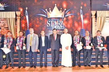 The top award winners with Minister of Public Enterprises Development Kabir Hashim and Chairman, Joint Managing Directors and representatives of the Senior Management of SLI.