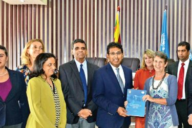 UN Resident Coordinator Una McCauley presenting the framework to National Policies and Economic Affairs Dr. Harsha De Silva.Ministry  National Policies and  Economic Affairs Ministry Secretary M. I. M. Rafeek, UNDP Regional  Director Haoliang Xu and officials look on.