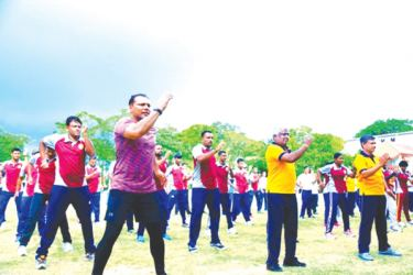 The Sports Minister Dayasiri Jayasekara is engaged in physical exercises during the event.