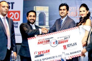 Seylan Bank's Head of Marketing and Sales Gamika de Silva (second from left) hands over the sponsorship cheque to Tyronne Chandrasekara - Chairman / Managing Director - Asia Exhibition & Conventions (Pvt) Ltd. Also present are Seylan Bank's Deputy General Manager - Consumer Finance Delvin Pereira and Subodha Basnayake - General Manager - Asia Exhibition & Conventions (Pvt) Ltd