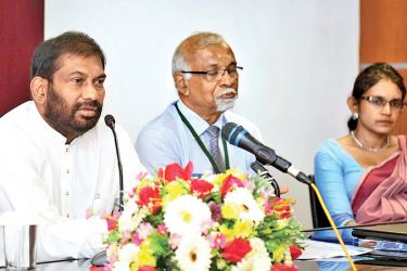 Primary Industries Minister Daya Gamage addressing the participants at the Workshop. Prof. D. N. Werasinghe and Kumuduni Gunasekera looking over.