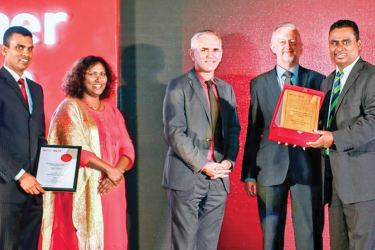 ICBT Campus CEO/Executive Director Dr. Mohan Pathirana accepting the 'National Patner of the Year' award