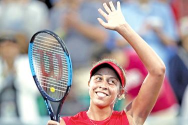 Madison Keys of US waves to the crowd after beating Wimbledon champion Garbine Muguruza 6-3, 6-2 on Saturday to book an all-American WTA Stanford final.- AFP