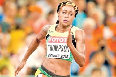 Elaine Thompson of Jamaica celebrates winning a heat in the women's 100m at the World Athletics Championships in London.