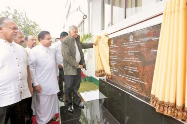 Prime Minister Ranil Wickremesinghe unveiling a plaque to open the modernised Ambewela milk factory.