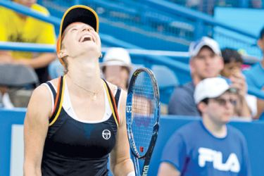 Russia's Ekaterina Makarova celebrates her win over Julia Goerges for her third career WTA crown. - AFP