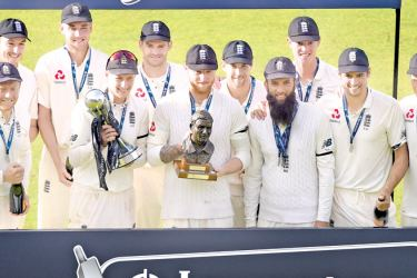 England players celebrate winning the fourth Test match, and Test series, against South Africa, on day 4 of the fourth Test match at Old Trafford cricket ground in Manchester on August 7. AFP