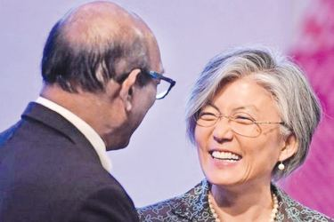 South Korean Foreign Minister Kang Kyung-wha meeting with her North Korean counterpart Ri Yong Ho in The Philippines on Sunday.