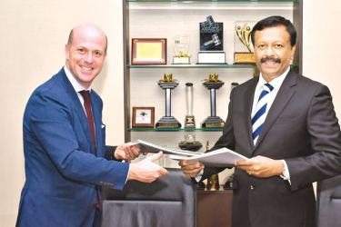 Signatories  Xavier Desaulles, CEO East and South Asia & Pacific (ESAP), Club Med SAS, and  Kapila Jayawardena, Group Managing Director,CEO, LOLC Group and Director Riverina Resorts Pvt Ltd. exchanging the agreements,