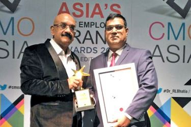 NDB Training Manager Rohan Manasseh receiving the awards