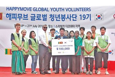 H. M. Sun, Deputy General Manager- Kia Motors Corporation Regional HQ/ Asia and Mahen Thambiah, Managing Director Kia Motors (Lanka) Limited with some of the Korean students at the symbolic presentation of Kia's contribution towards the construction of the pre-school building.