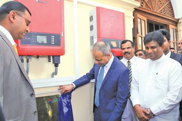 Law and Order and Southern Development Minister Sagala Ratnayake and Power and Renewable Energy Deputy Minister Ajith P. Perera commissioning the newly established solar energy system at Royal College. Picture by Chinthaka Kumarasinghe.