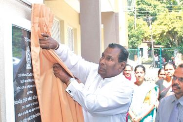 Labour and Trade Union Relations Minister  W. D. J. Seneviratne unveils the plaque to mark the opening of the new building at Avissawella District Labour Secretariat.