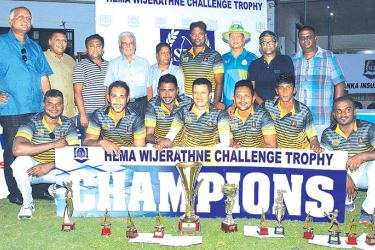 The champion Janashakthi Insurance cricket team with the Hema Wijeratne Challenge Trophy and other special awards.