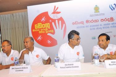 Health Minister Dr. Rajitha Senaratne in conversation with Megapolis and Western Province Development Minister Patali Champika Ranawaka during the dengue control programme in Colombo.