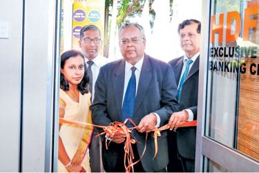 HDFC Chairman R. J. De Silva opening the loan centre. M. Surendran a Director of HDFC, Upali Hettiarachchi the CEO and General Manager and Udeni Fernando Officer-in-charge of the Exclusive loan Centre look on.