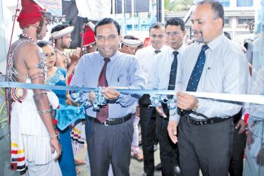 RDB General Manager and CEO T.A. Ariyapala opening the branch, with other officials.