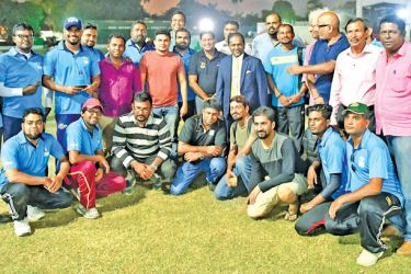 The winning Sri Lankan Media team pose with the winning trophy with SLC president Thilanga Sumathipala after the presentation ceremony.    (Picture by Jagath Kalupahana)