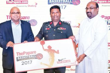 Sri Lanka Basketball Federation (SLBF) president Brig. Indunil Ranasinghe (centre) and Brother J. Kanthan (SLBF secretary) receiving the sponsorship from Head of Business, Global Content and Services, Dialog Axiata PLC., Mangala Hettiarachchi (left extreme)