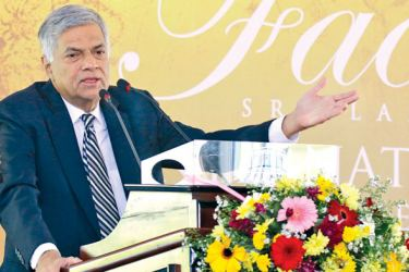 Prime Minister Ranil Wickremesinghe addressing the opening of the FACETS International Gem and Jewellery Exhibition at the BMICH yesterday. Picture by Hirantha Gunathilaka
