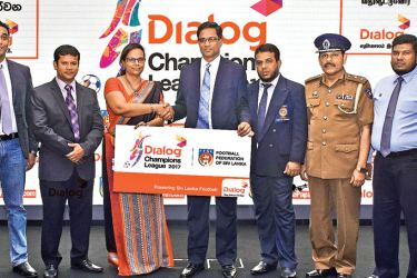 Amali Nanayakkara, Group Chief Marketing Officer of Dialog Axiata PLC, presenting the sponsorship cheque to Anura De Silva, President - Football Federation of Sri Lanka for the Dialog Champions League 2017. (L-R) Harsha Samaranayake – General Manager (Brand & Media - Dialog Axiata PLC), Jaswar Umar (Secretary General, FFSL), Zaharan Singawansa (Chairman Competitions FFSL), DIG Padmasiri Munasinghe (Vice President of the FFSL) and M. Asif Ansar ( Manager- Competitions).